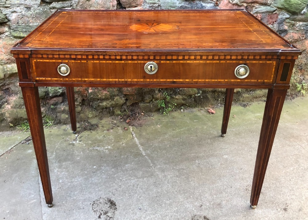 an c18th italian mahogany and inlaid writing table