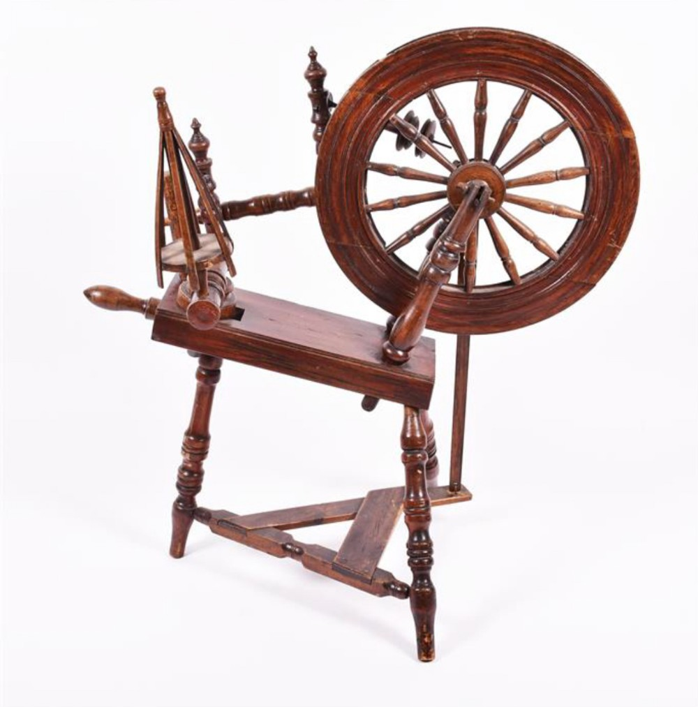 an early c19th oak spinning wheel