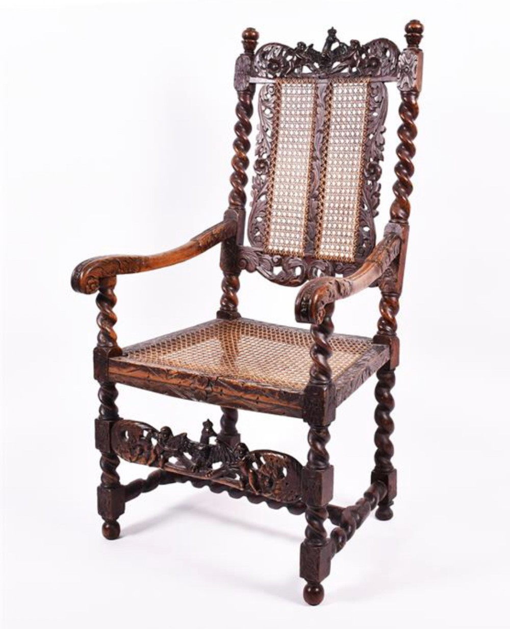a c17th walnut carved armchair