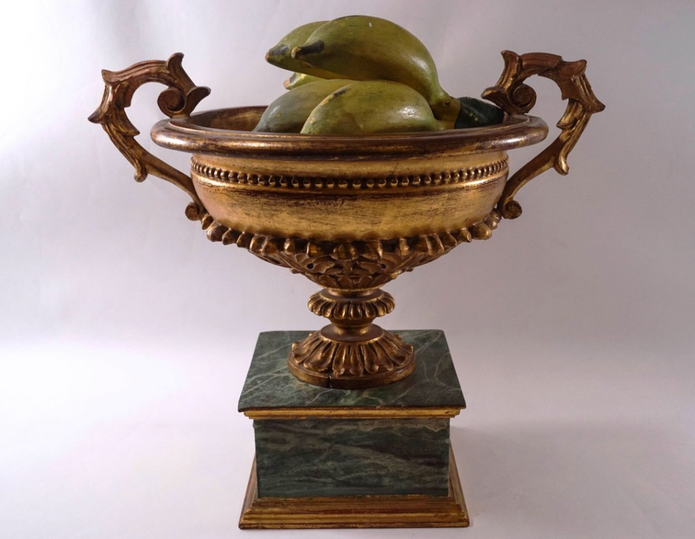 a decorative carved wooden urn
