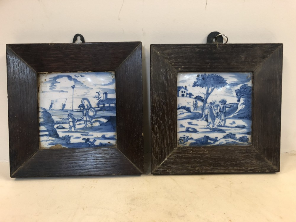pair of c17th delft tiles in wooden frames