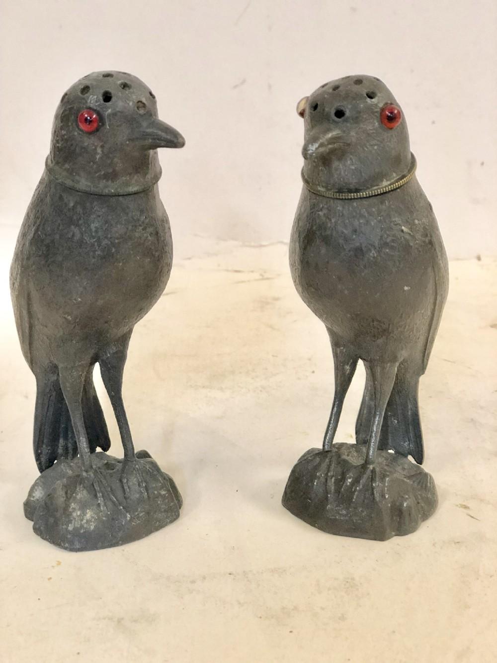 a novelty pair of spelter pepper pots modelled as birds