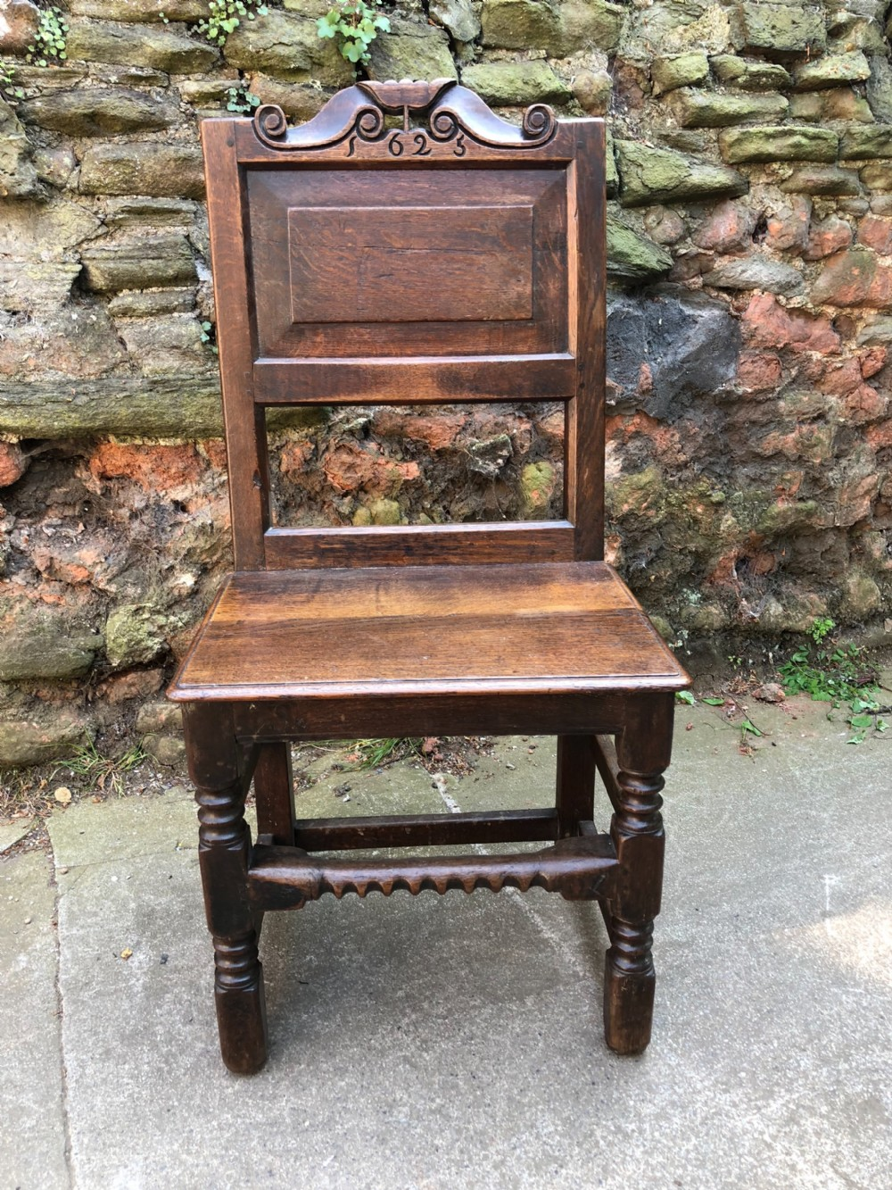 c17th oak chair with later date 1625