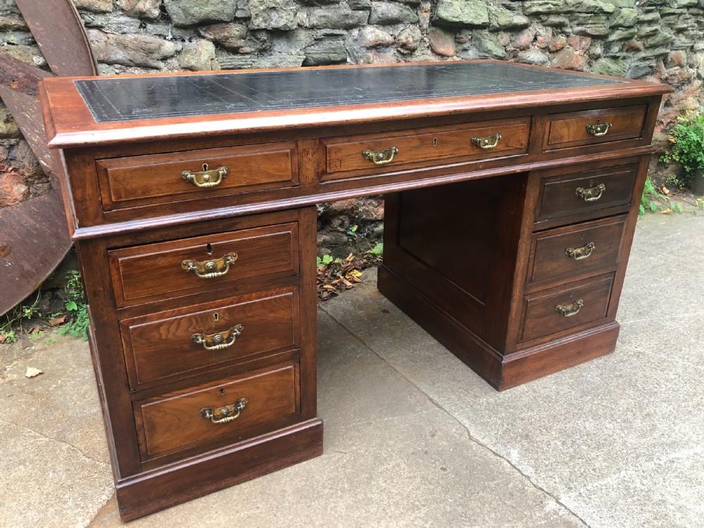 c19th walnut nine drawer pedestal desk with inset leather top