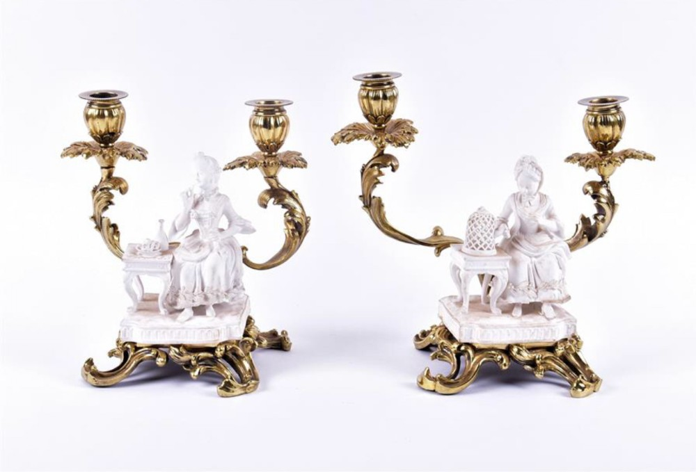 pair of biscuit figures mounted on double candlesticks and stand