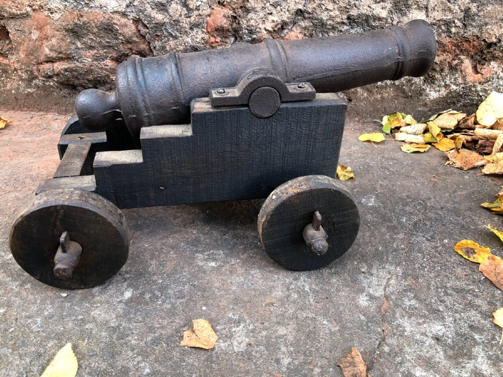 c19th small cannon on wood and cast iron stand