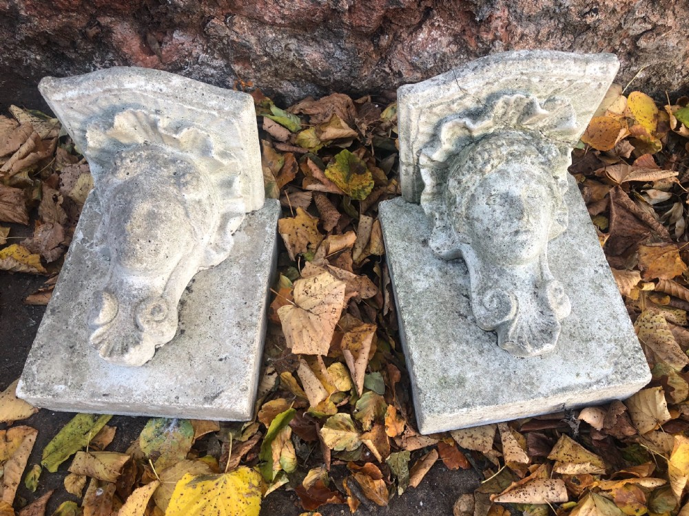 early 20th pair cast stone corbels mounted on stone backs