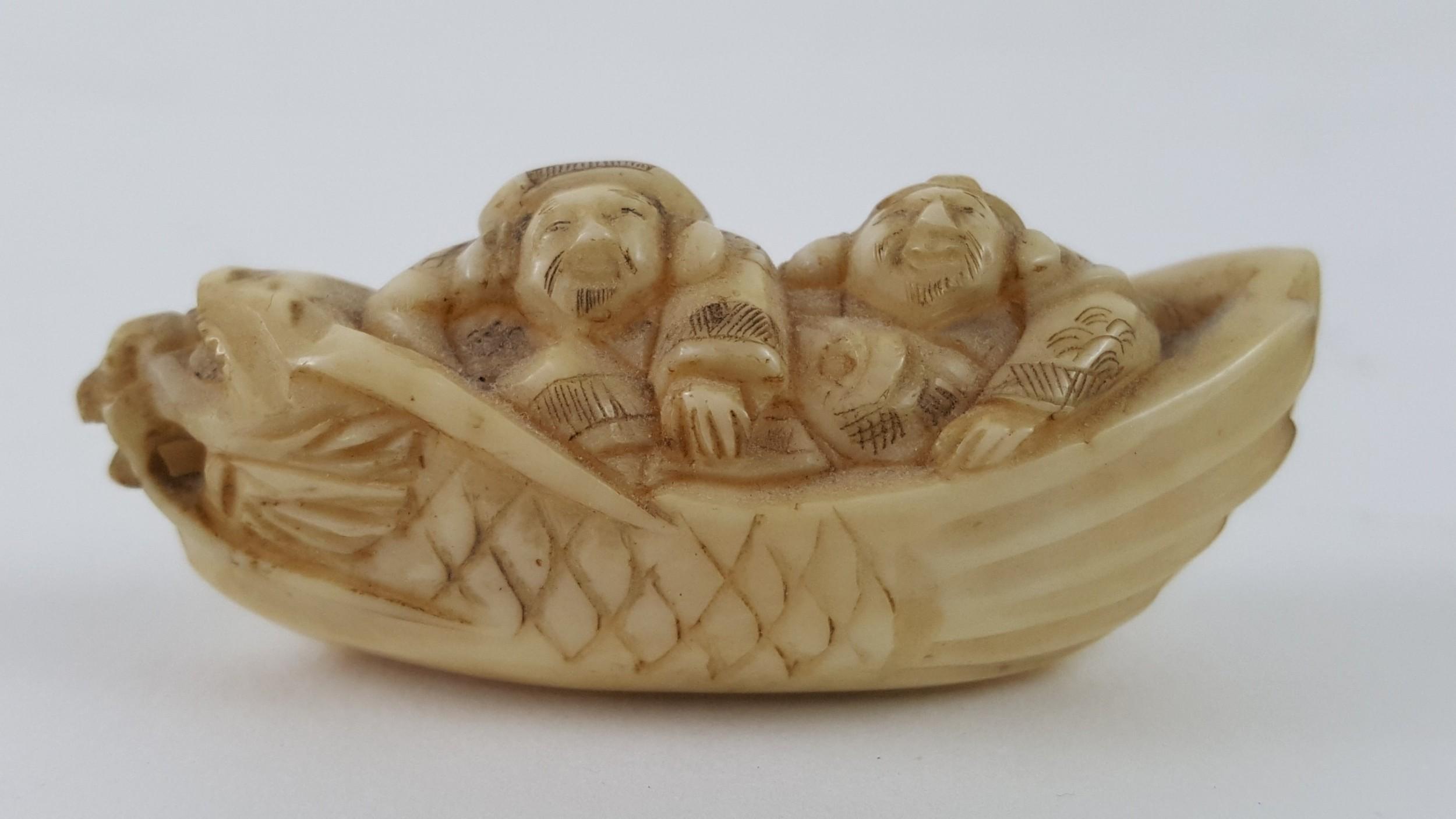 meiji period japanese ivory netsuke of two men in boat