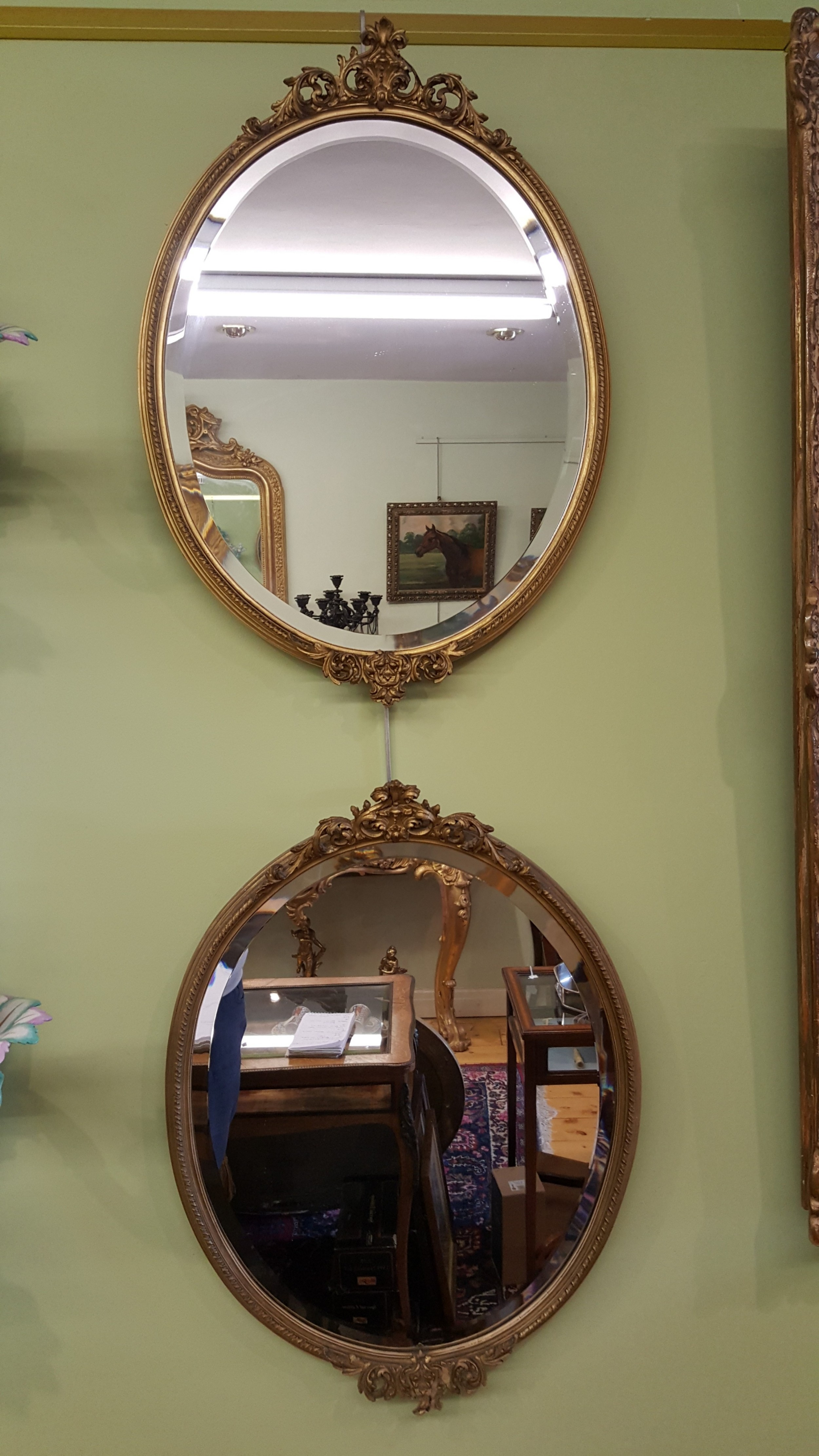 pair of early 20th century french oval gilt mirrors
