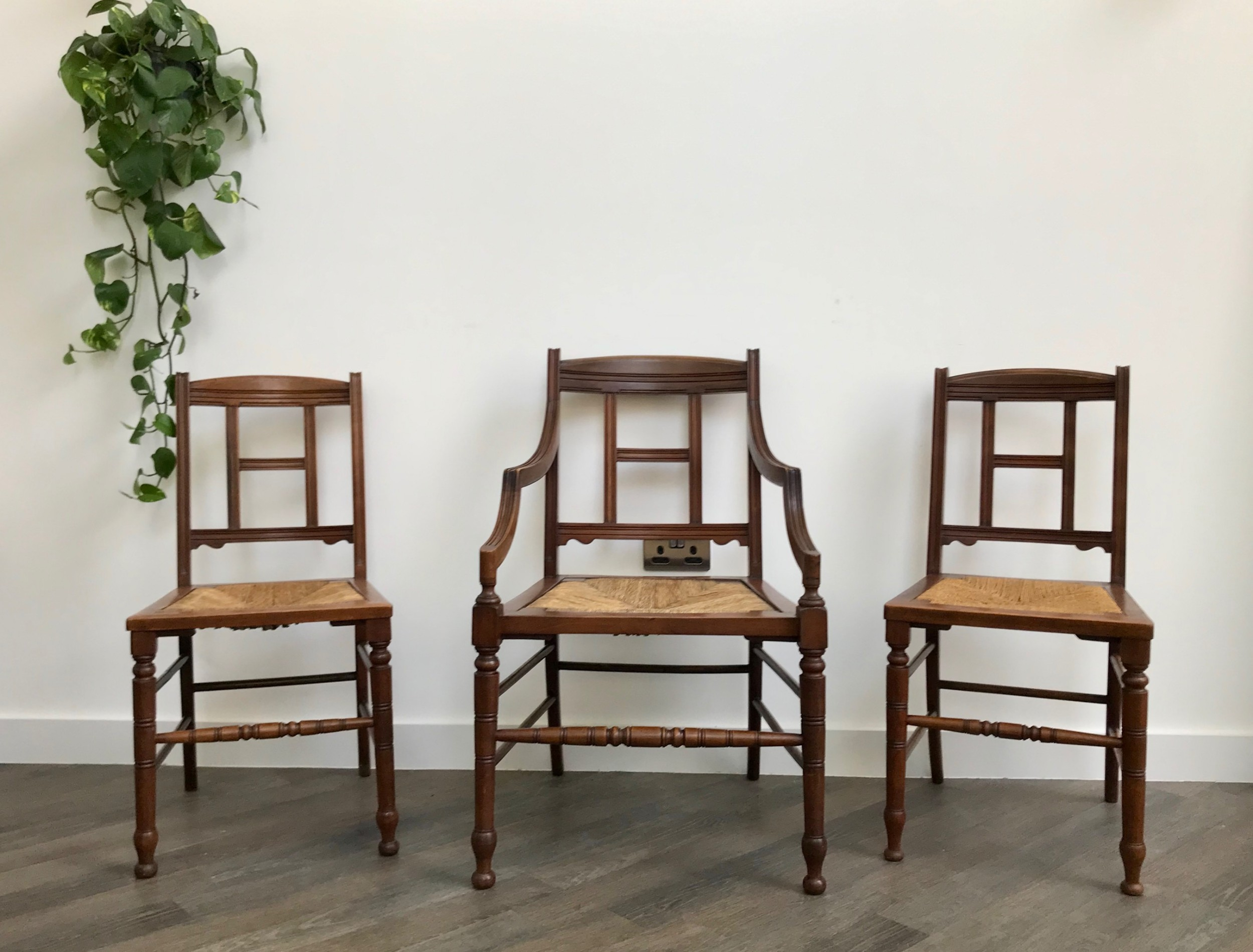 a set of late 19th century walnut chairs with rush seats one carver armchair and two occasional chairs late victorian furniture with lovely colouring