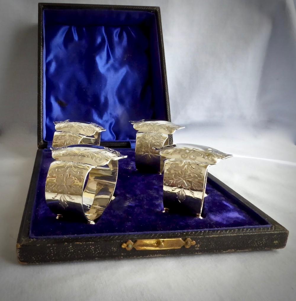 set of four edwardian unusual napkin rings in original velvet lined box