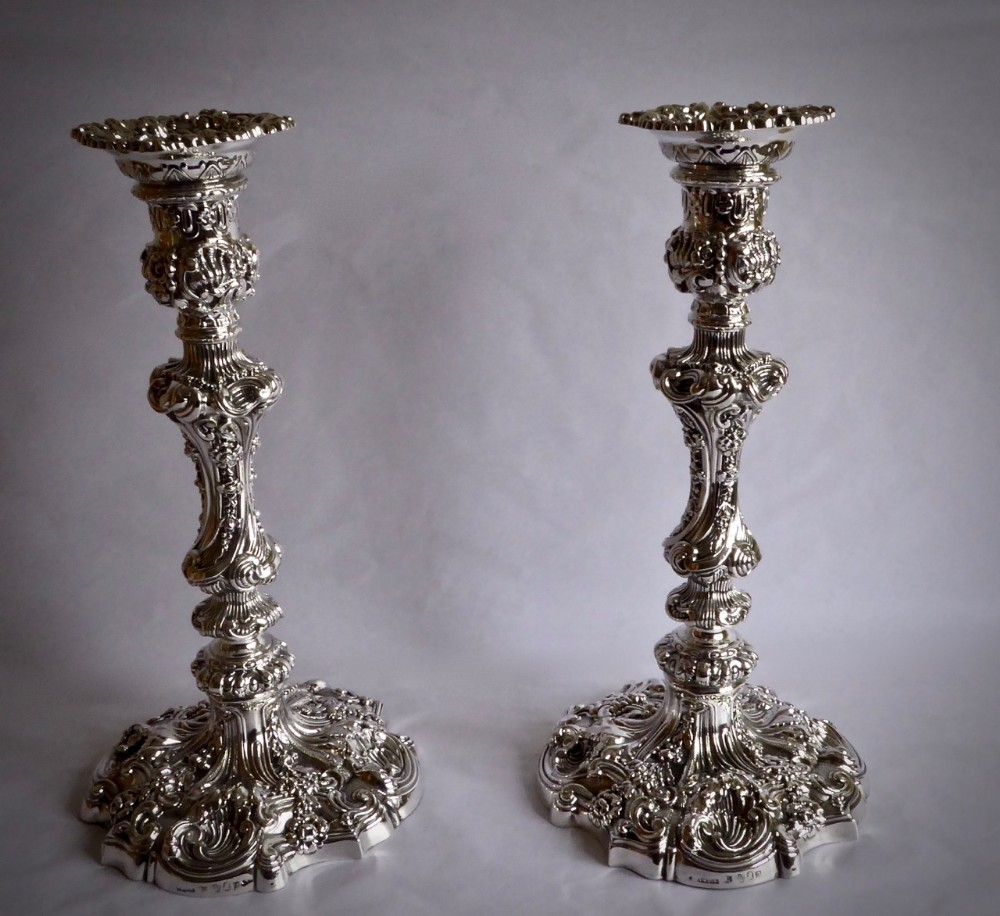 a fine pair of george iv highly decorative embossed silver candlesticks