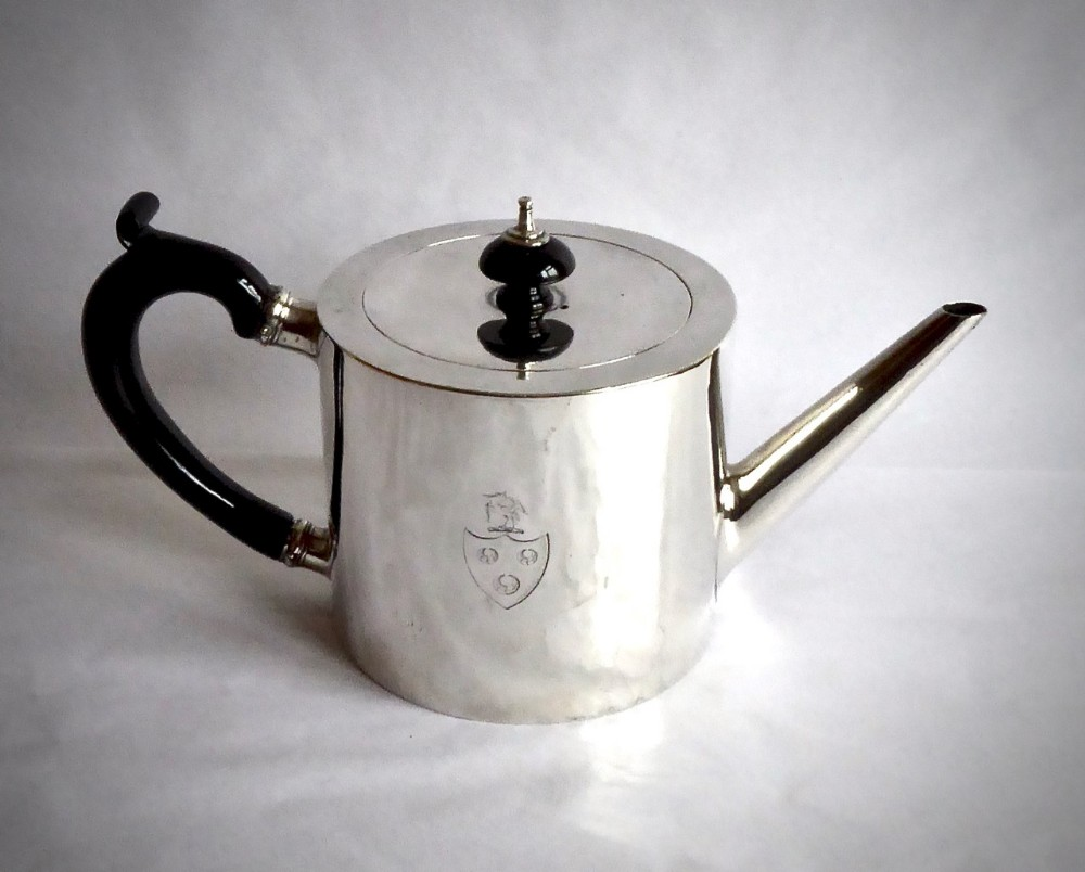 a good george iii 'drum' teapot with original crest