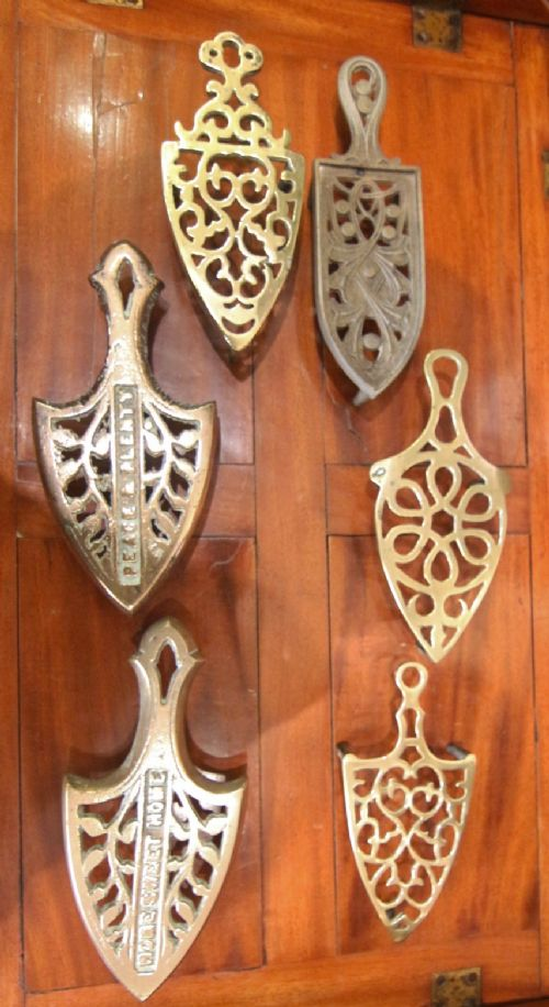 collection of 6 brass iron stands ' home sweet home'