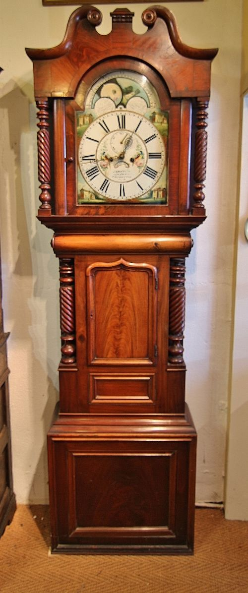 a cheerful 19th century mahogany arch dial longcase grandfather clock j griffiths carenarfon