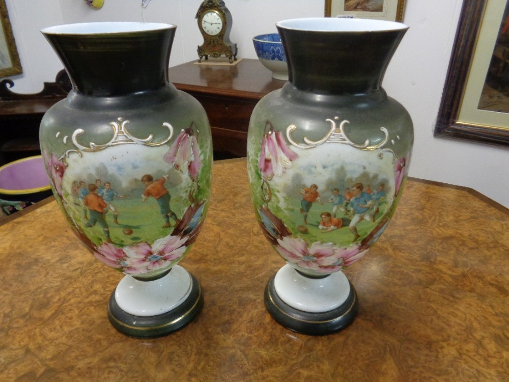 antique pair of opalescent glass vases with football decoration