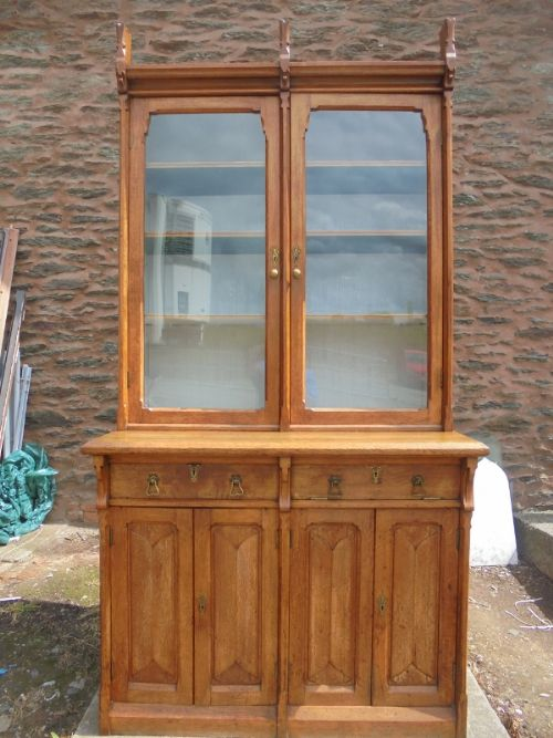 oak two door bookcase in the manner of pugin gothic arts and crafts