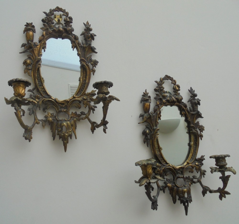 ornate pair of french gilded wall mirrors with candle sconces