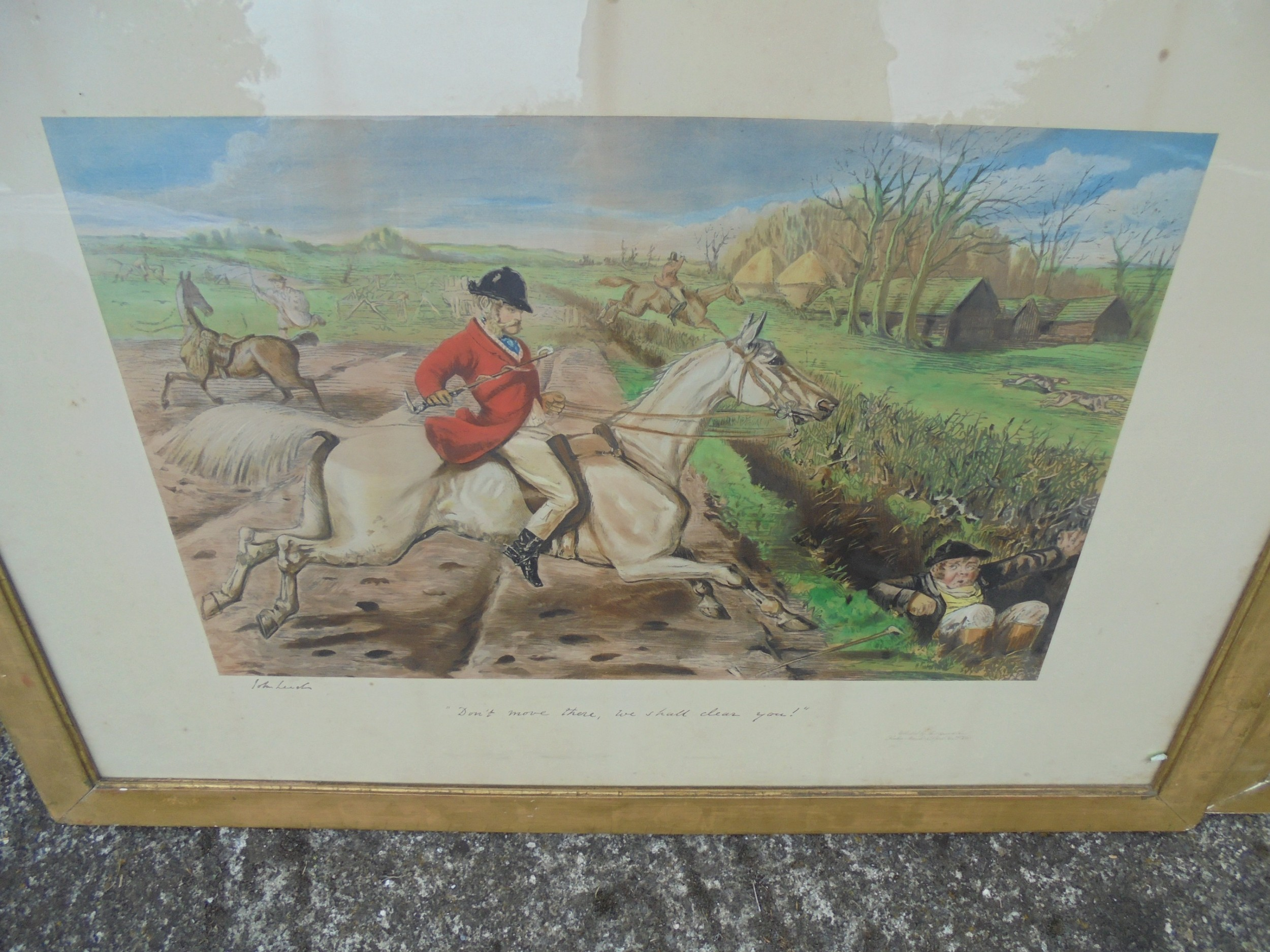 pair of framed humorous hunting prints with captions