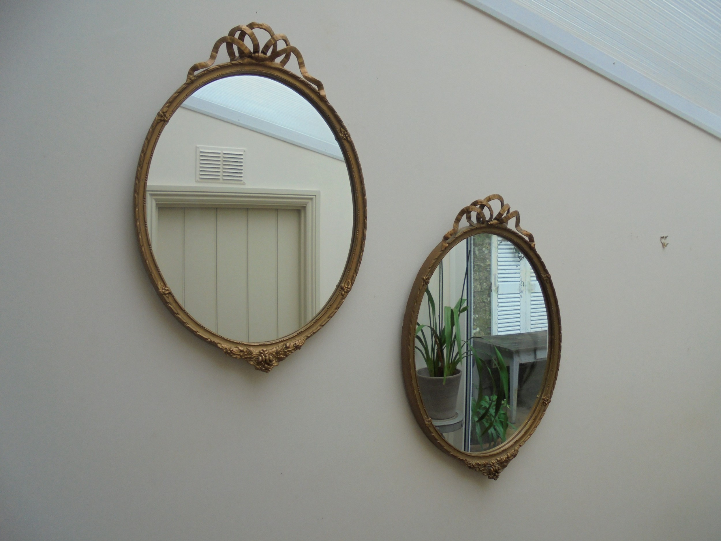 pair of victorian oval gilded wall mirrors