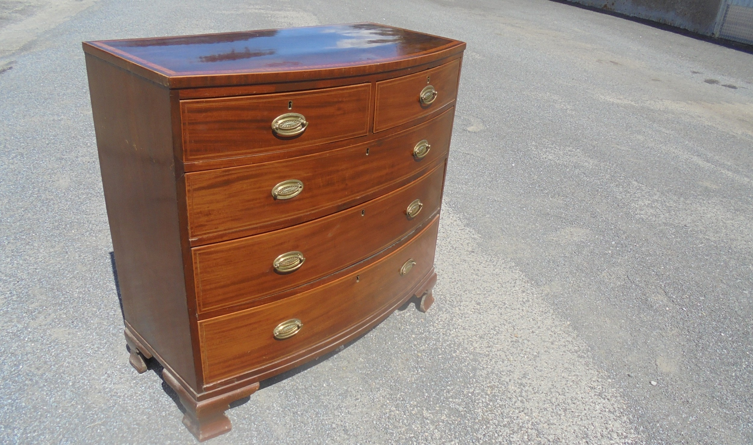 late regency inlaid bow fronted chest of drawers