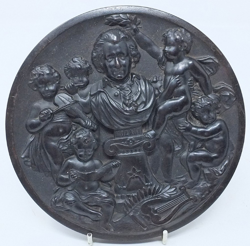 19th c 'bois durci' relief portrait plaque of w a mozart 16cm with musical cherubs
