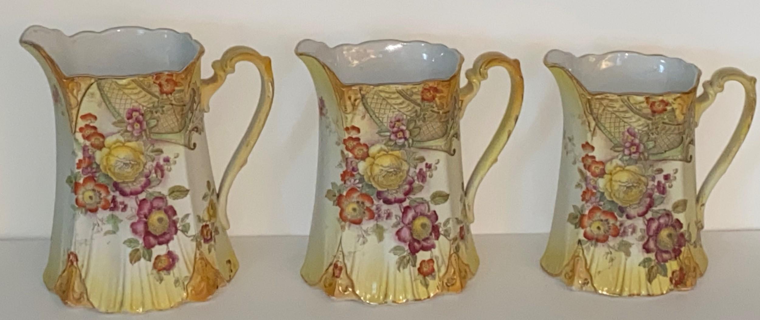 three graduated antique jugs