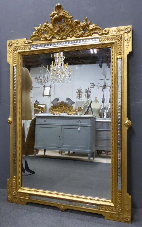 gilt crested antique mirror with facet glass to outer frame