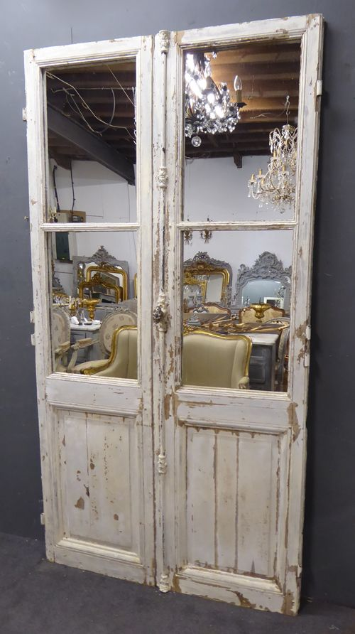 pair of large mirrored 19th century antique french oak doors