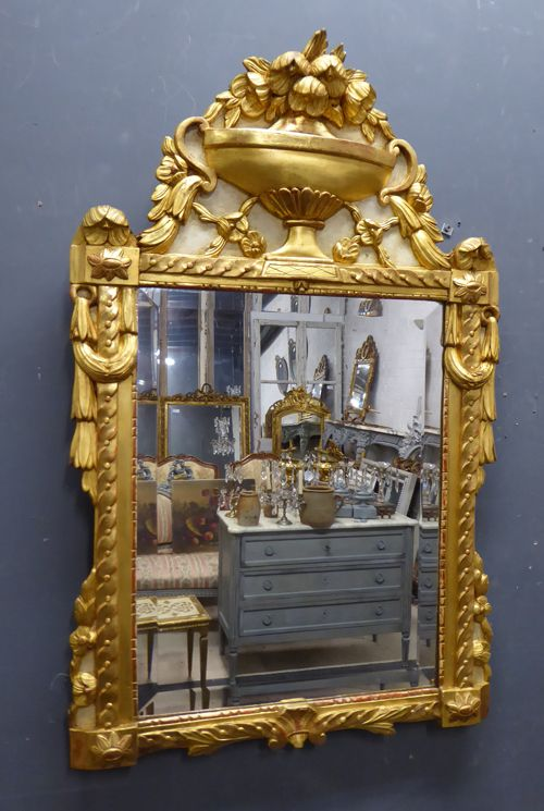 french carved giltwood urn crested antique mirror