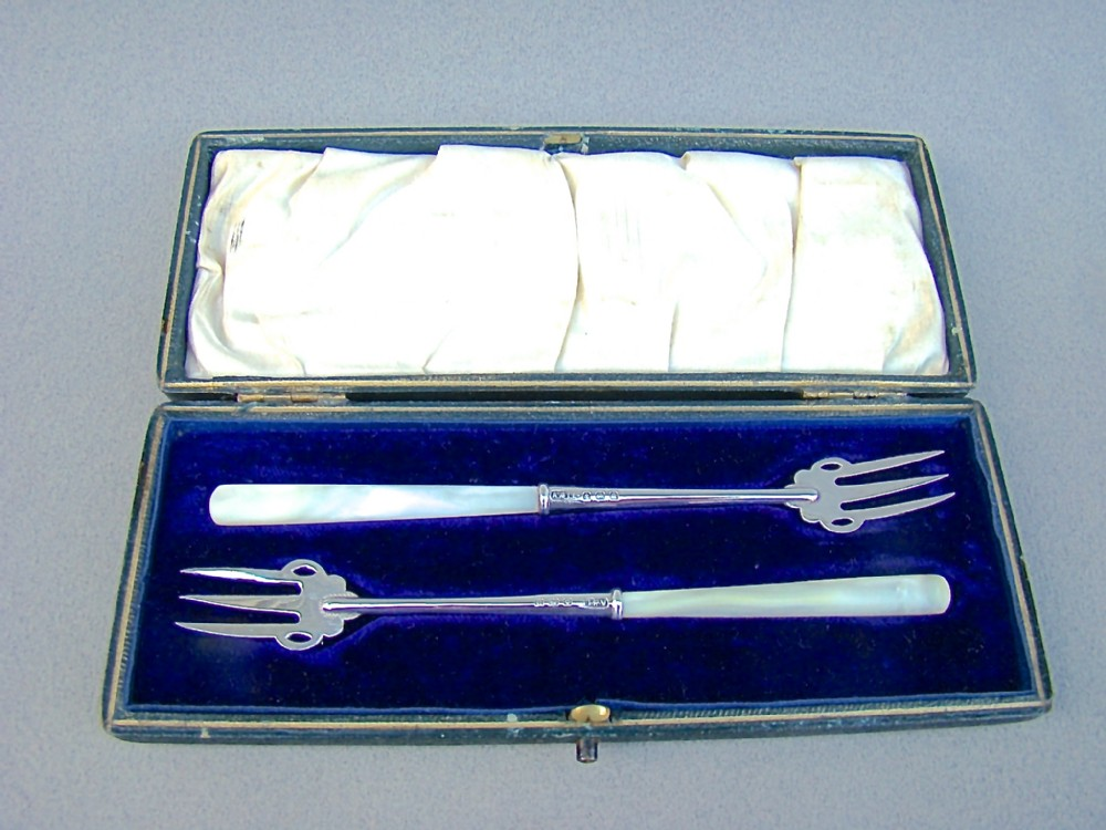 cased pair of george v silver caviar forks by adie lovekin birmingham 1912