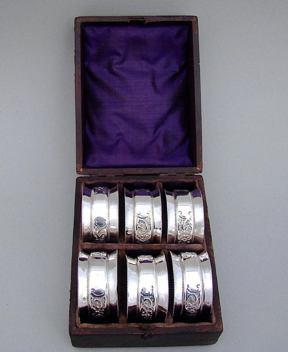 cased set of six victorian sterling silver napkin rings by edward samuel jones birmingham 1896