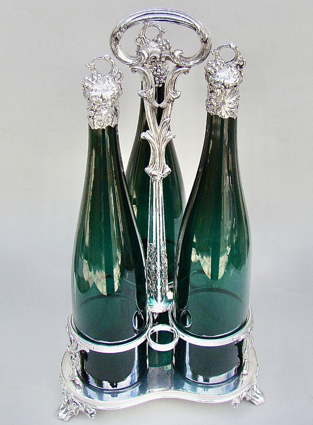 fabulous set of three victorian silver mounted bristol green glass decanter by henry wilkinson co birmingham 1839 in their original silver plated stand