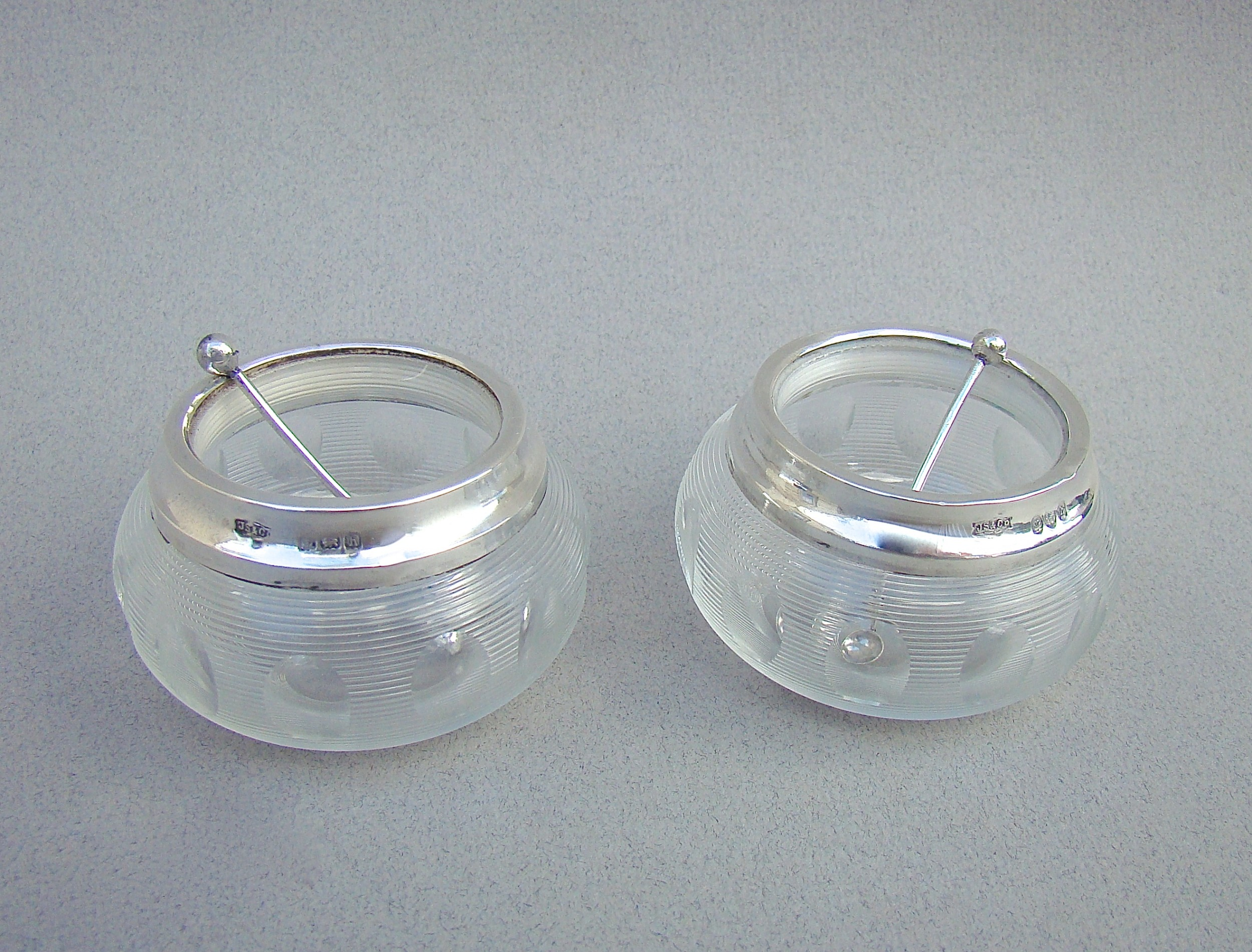 pair of edwardian silver and ribbed glass salts by john grinsell birmingham 1906