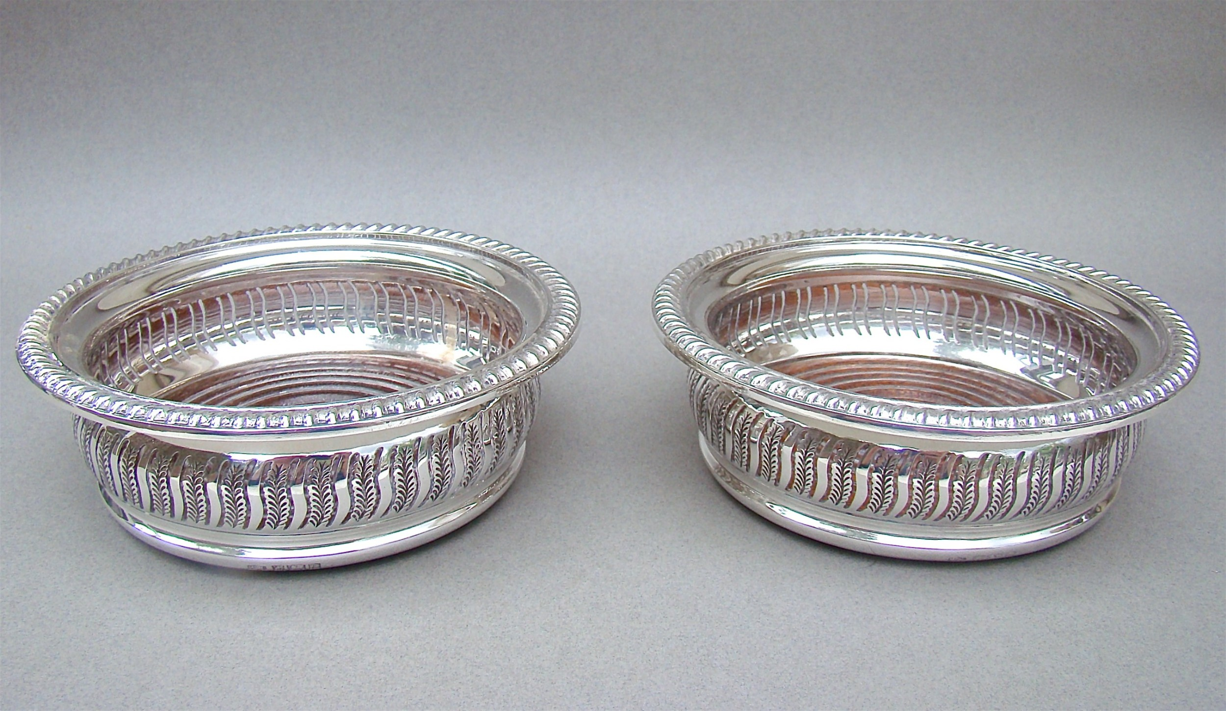 superb pair of mid 20th century solid silver wine coasters by mappin webb birmingham 1968