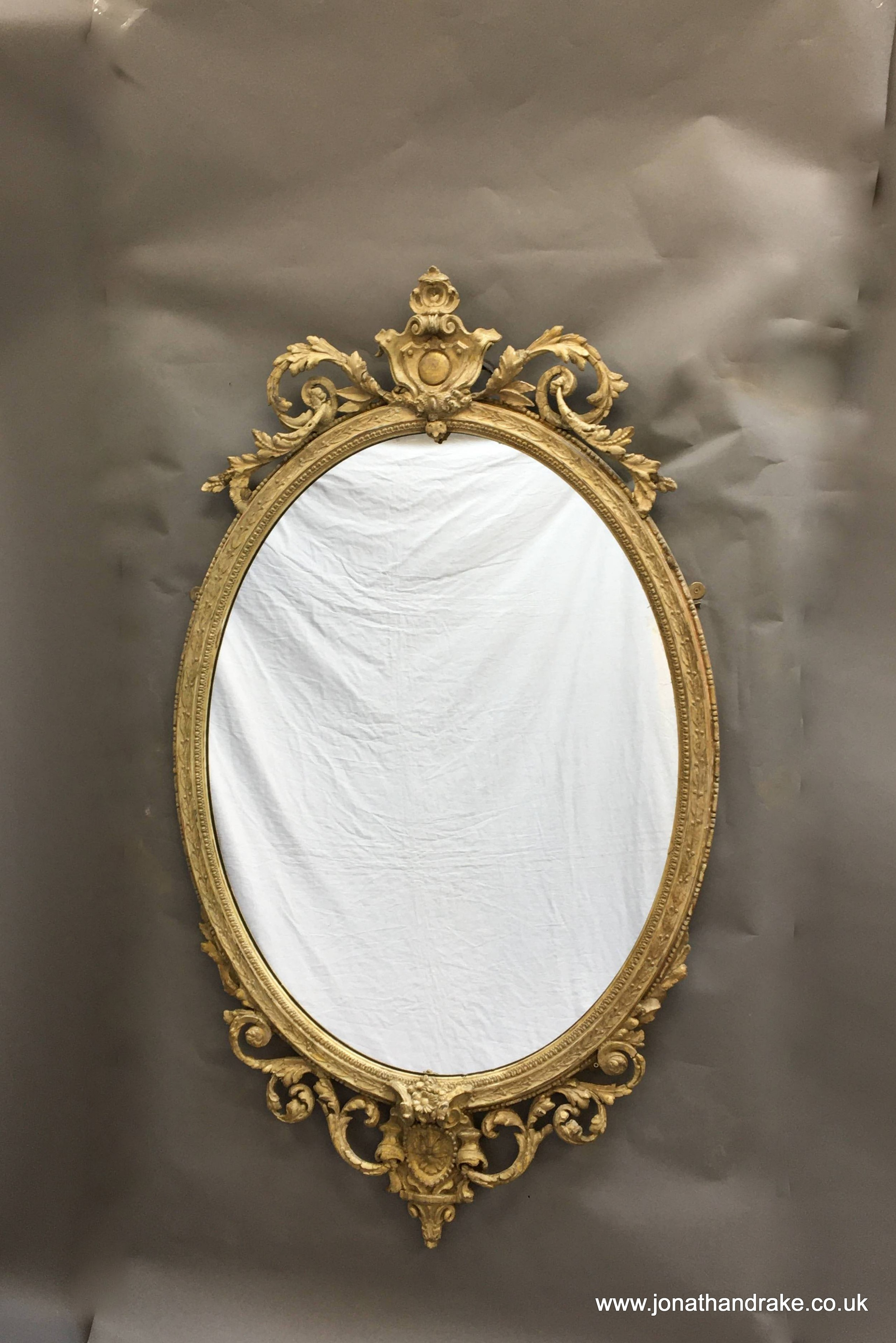 c19th ornate oval overmantle mirror