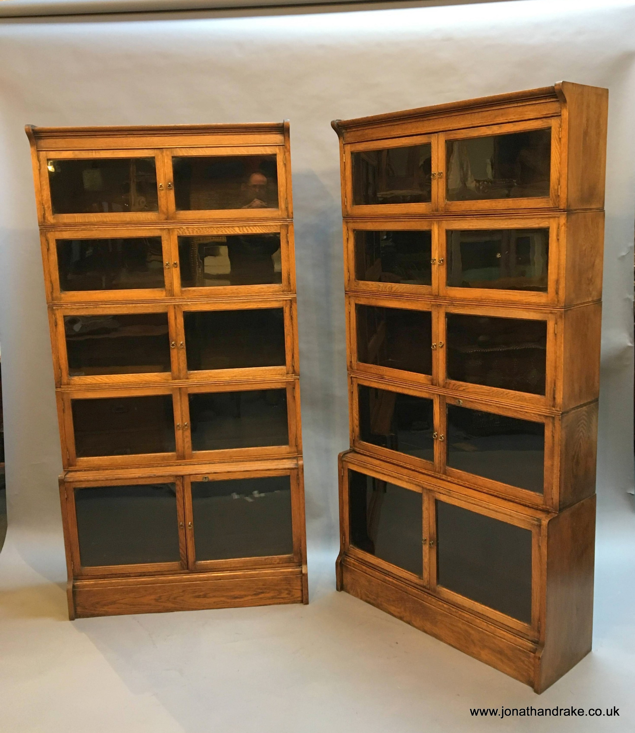 pair globe wernicke type bookcases by oxford