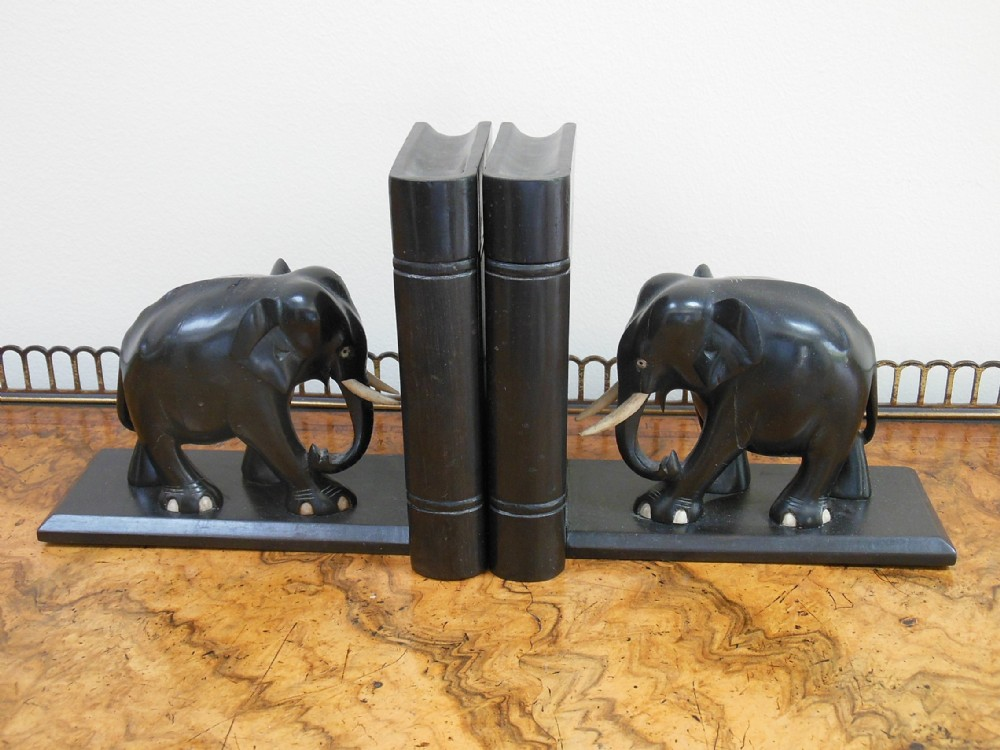 Ebony and ivory elephant bookends