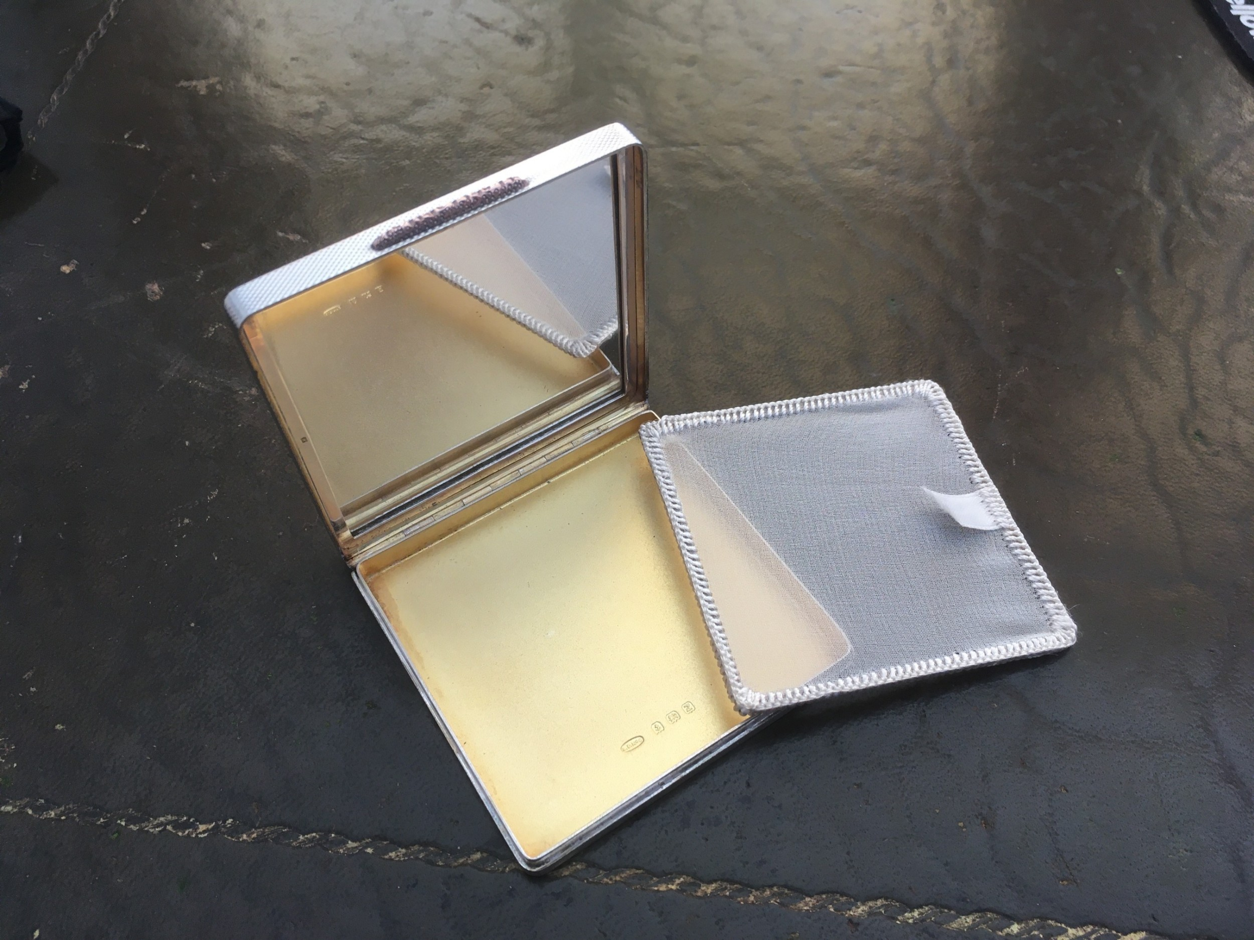 silver and gold powder compact
