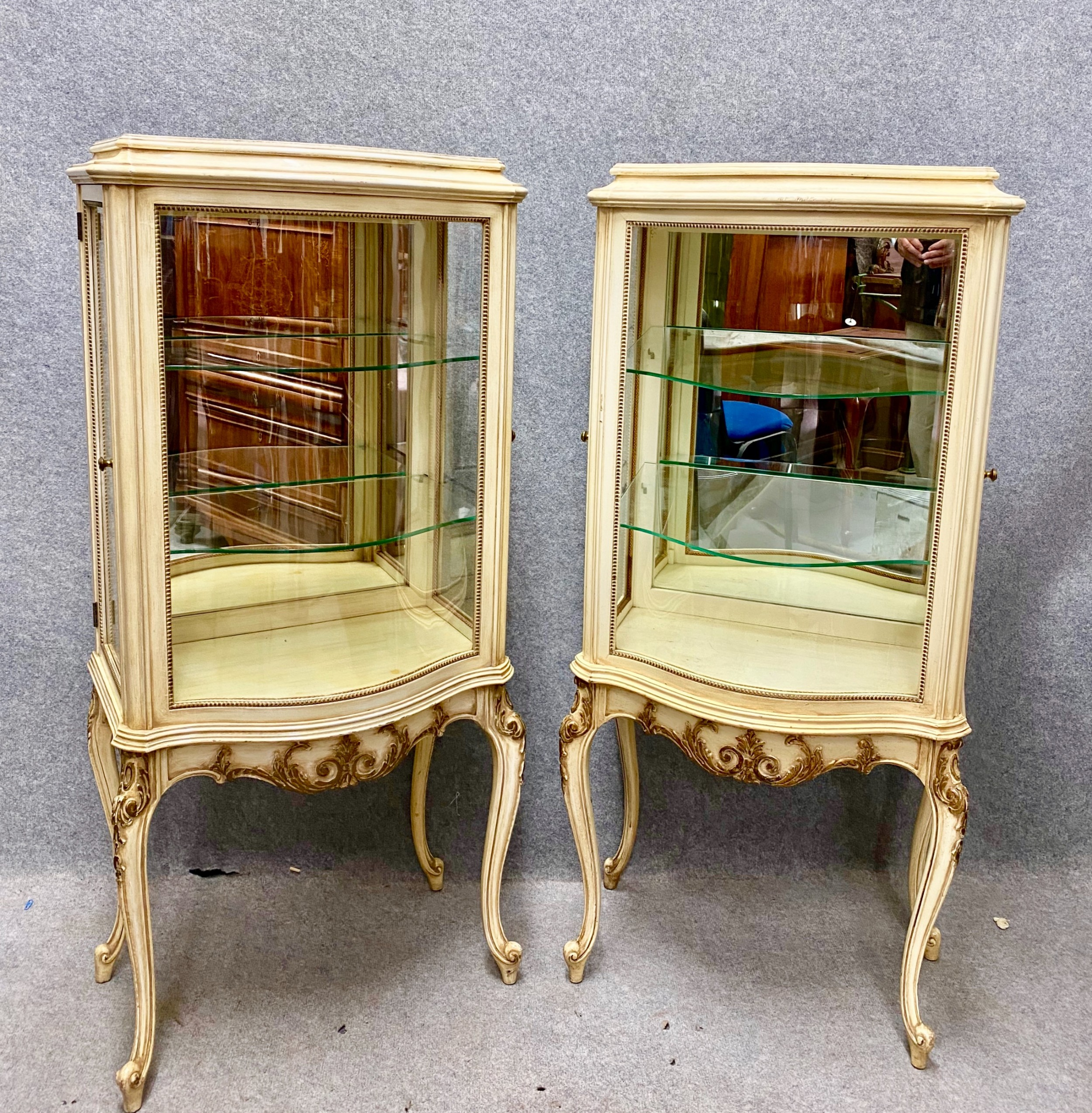 pair painted french style display cabinets
