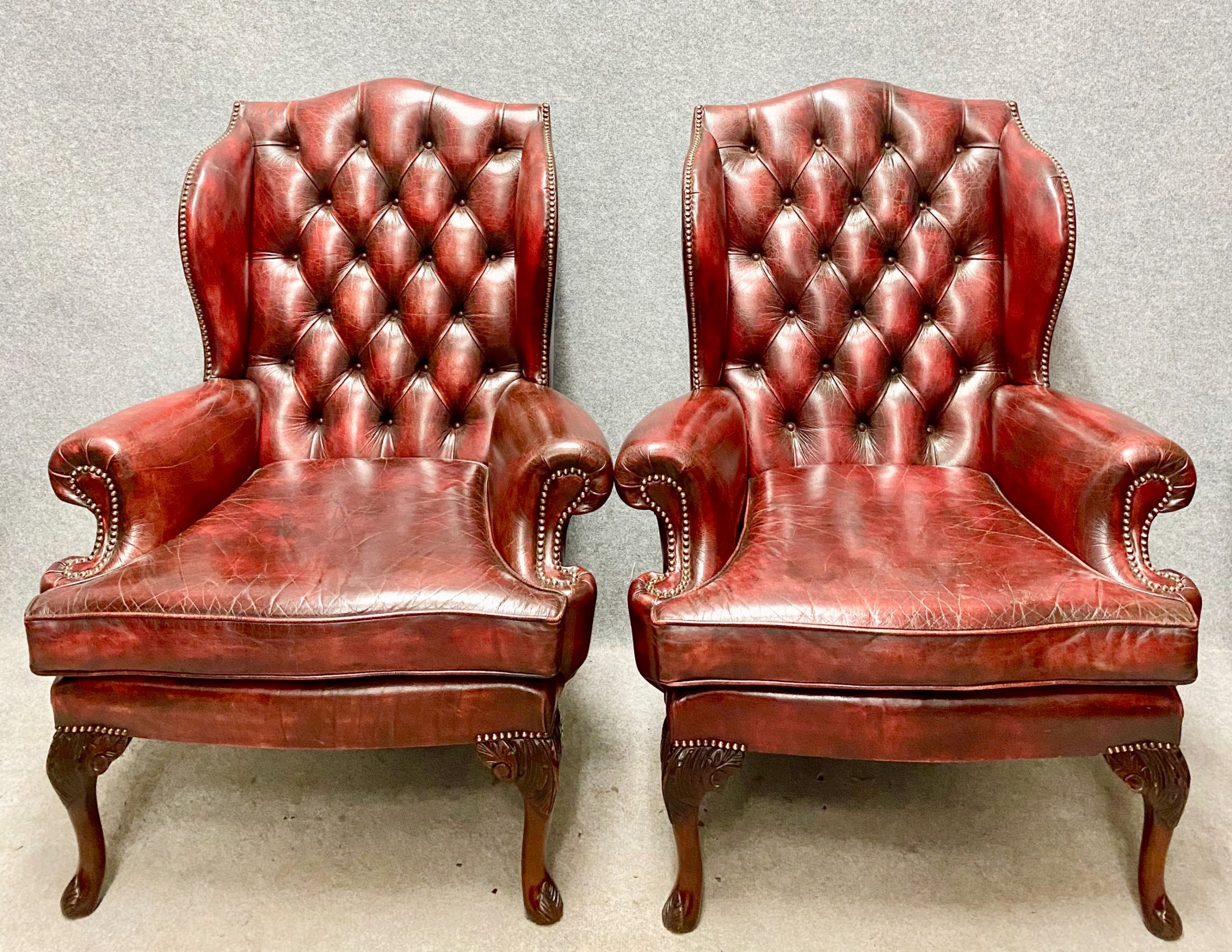 pair of leather wing armchairs