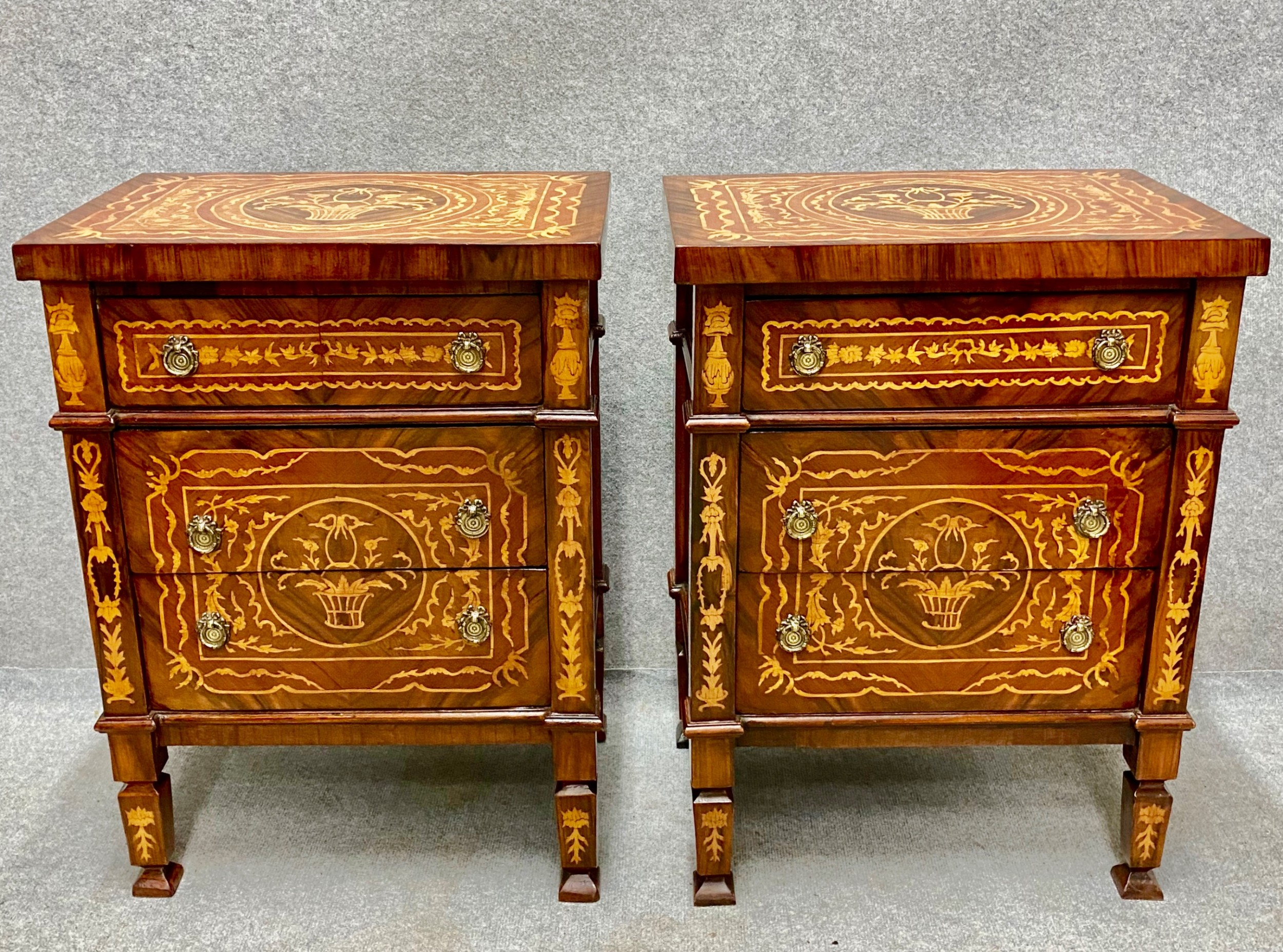 good pair of marquetry inlaid bedside chests