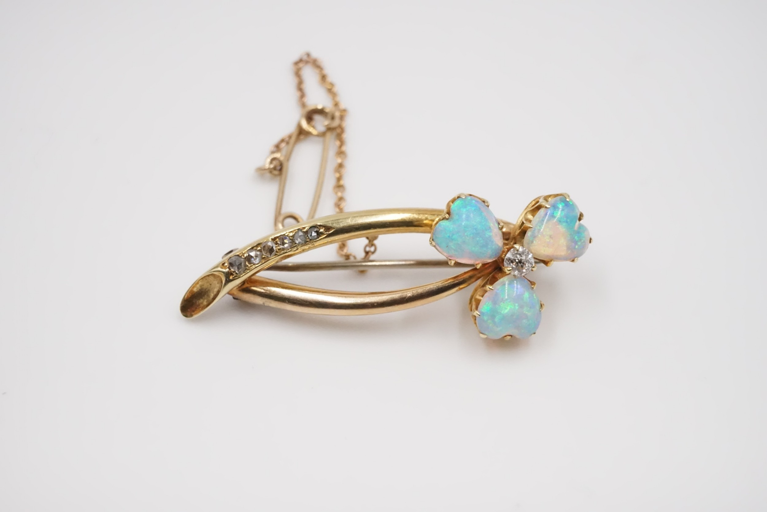 a 18ct gold brooch with top quality opal hearts and diamonds circa 1900