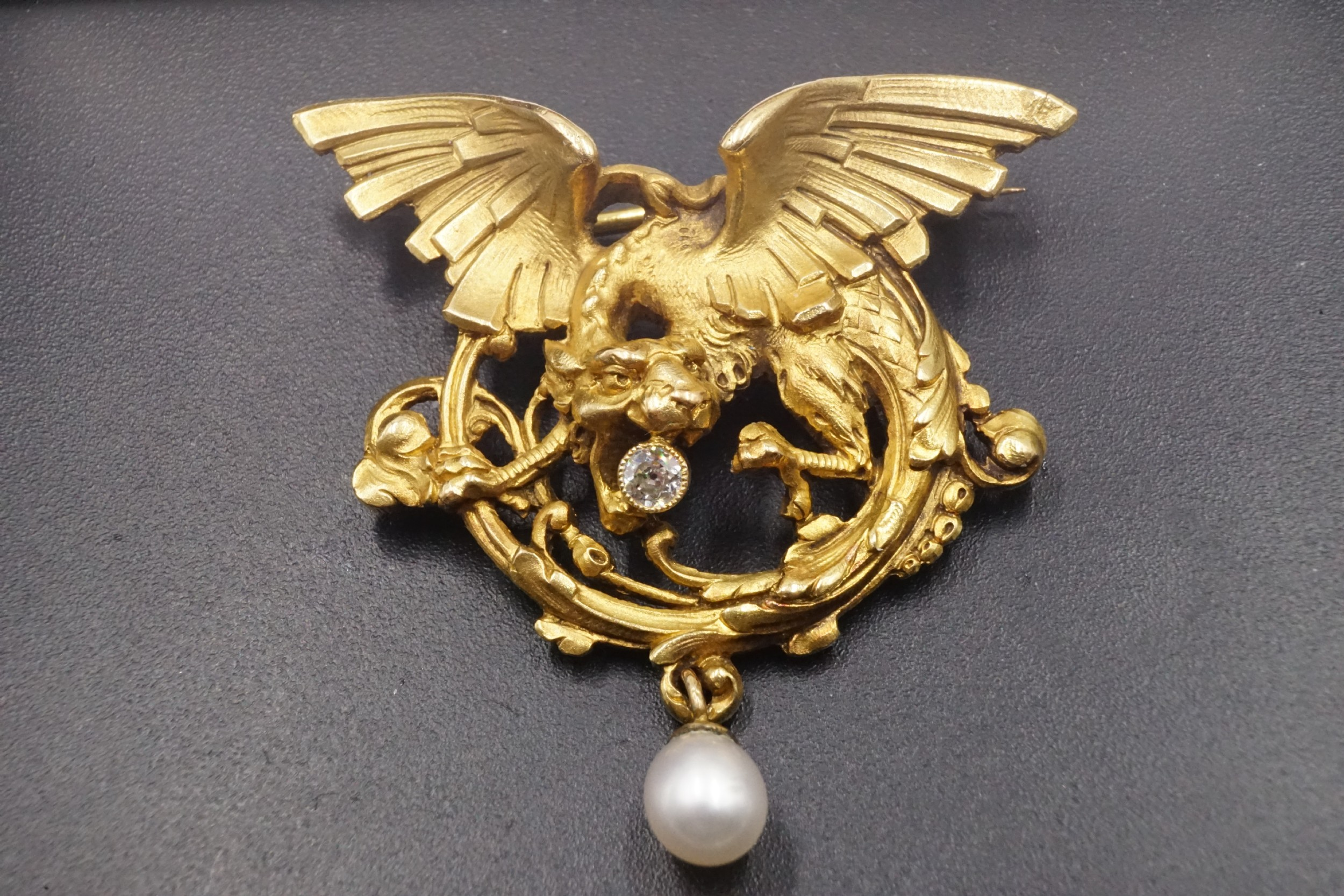 an art nouveau french diamond natural and 18k gold griffin brooch with french assay mark and maker's mark