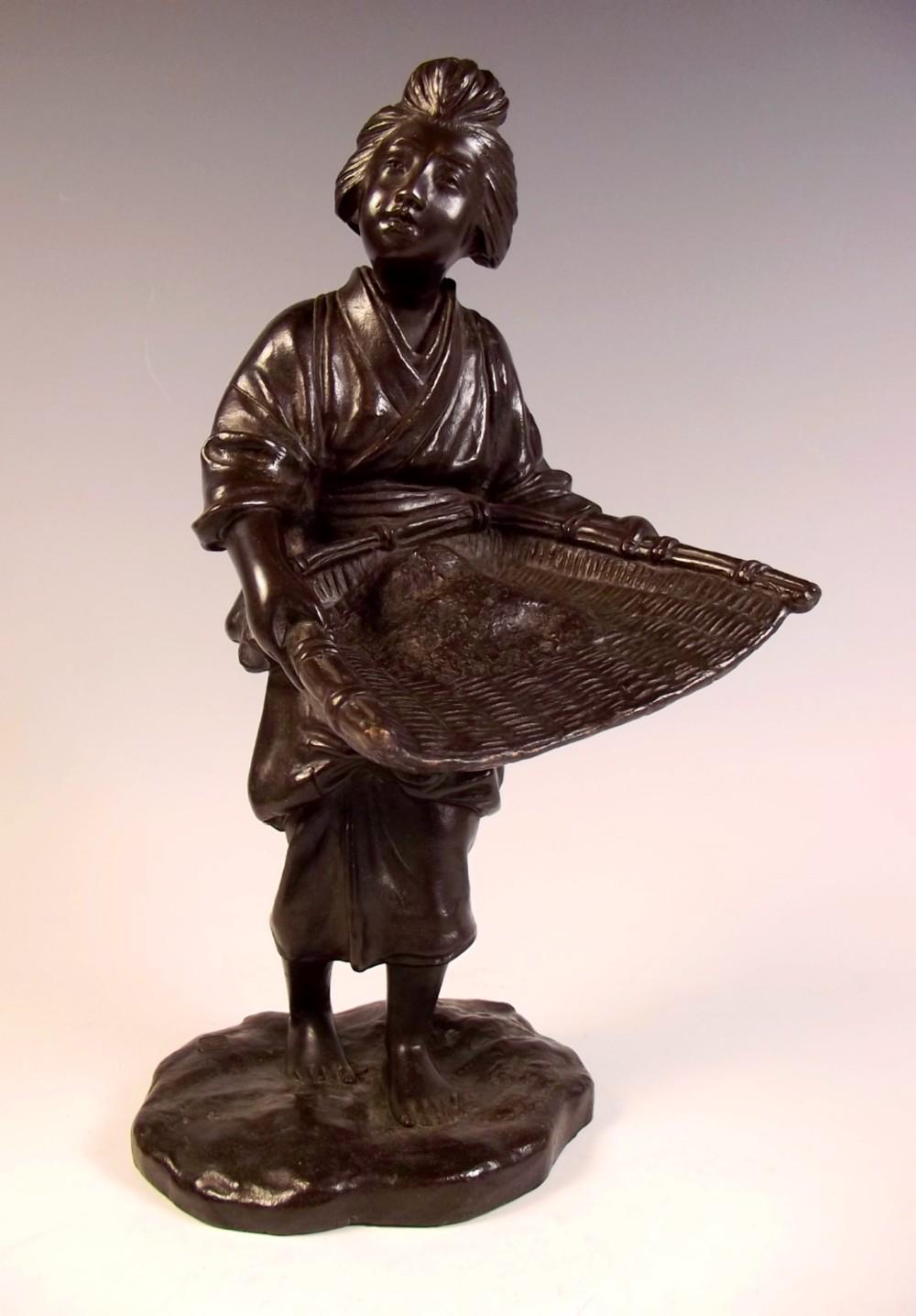 japanese bronze okimono of a rice sifter seiya meiji period