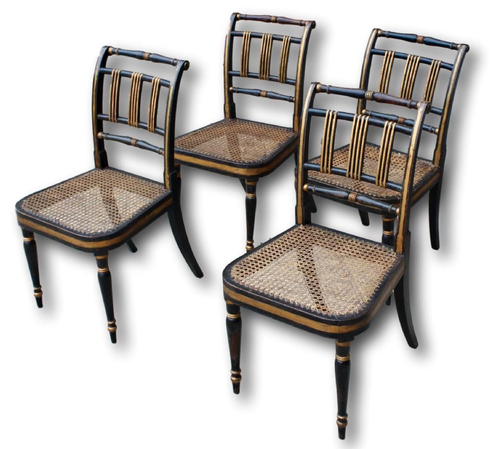 set of four regency gilt ebonised chairs