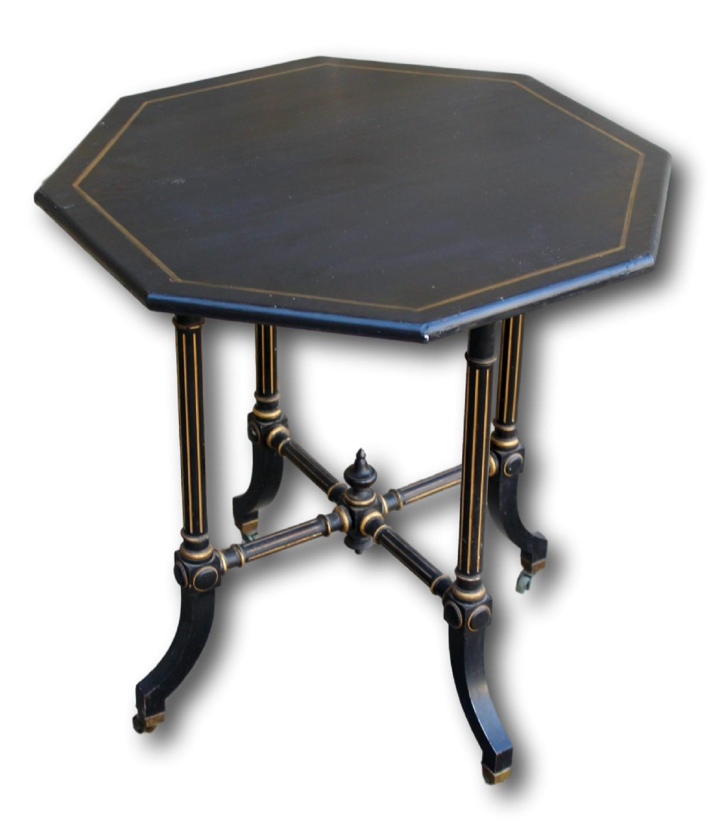 ebonised occasional table in the manner of gillows