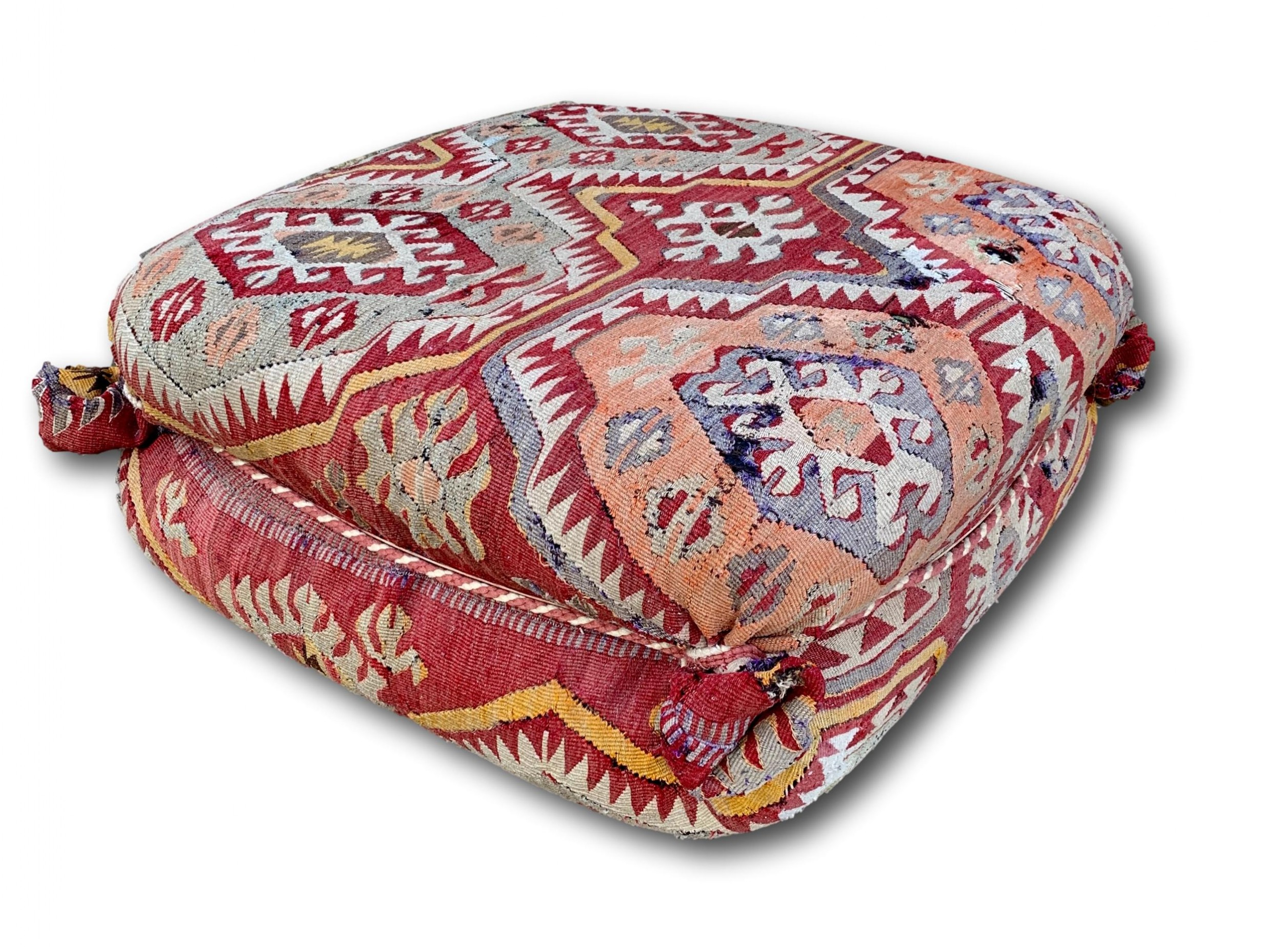 large 20th c kilim covered foot stool