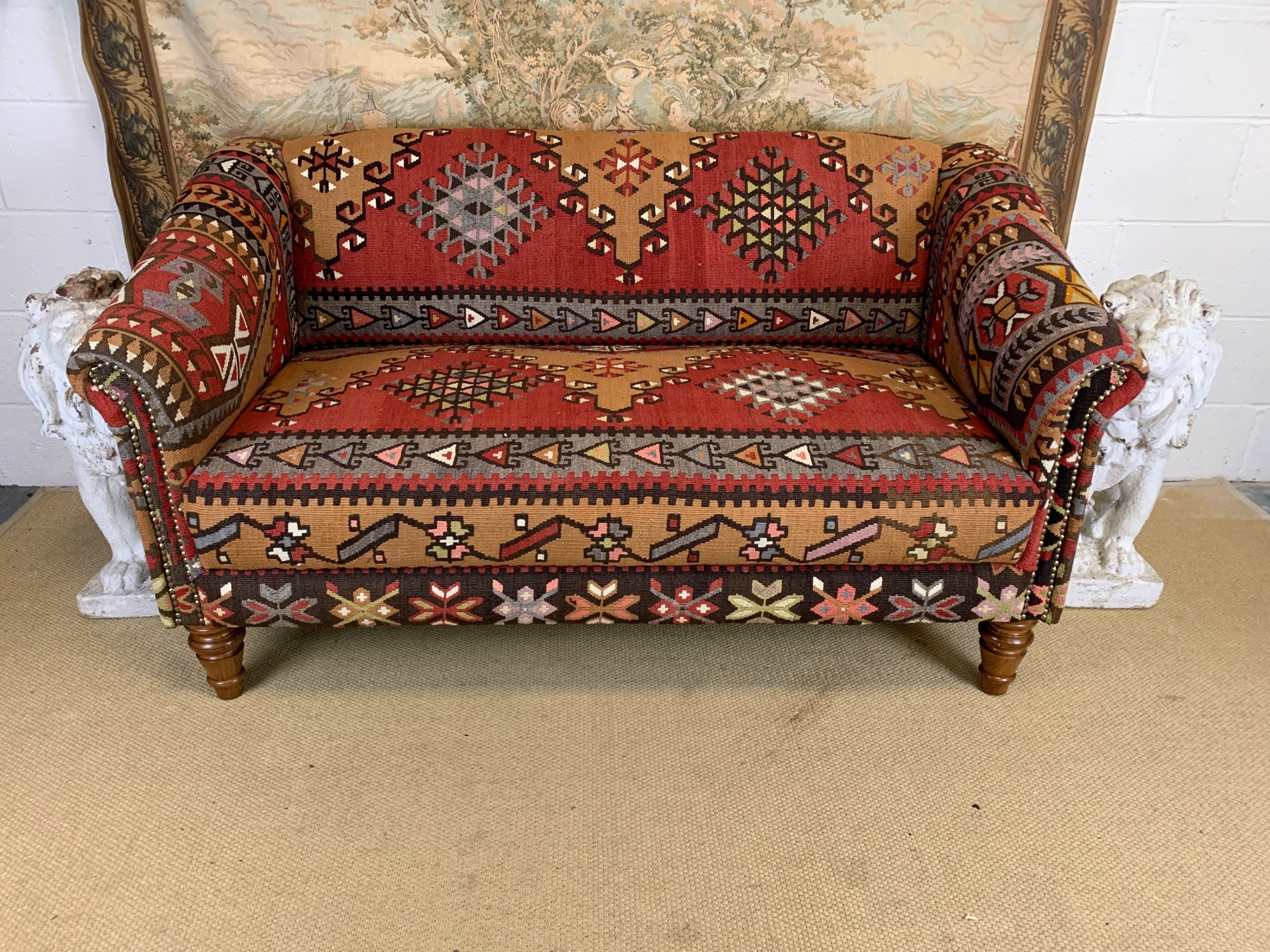 antique kilim covered settee