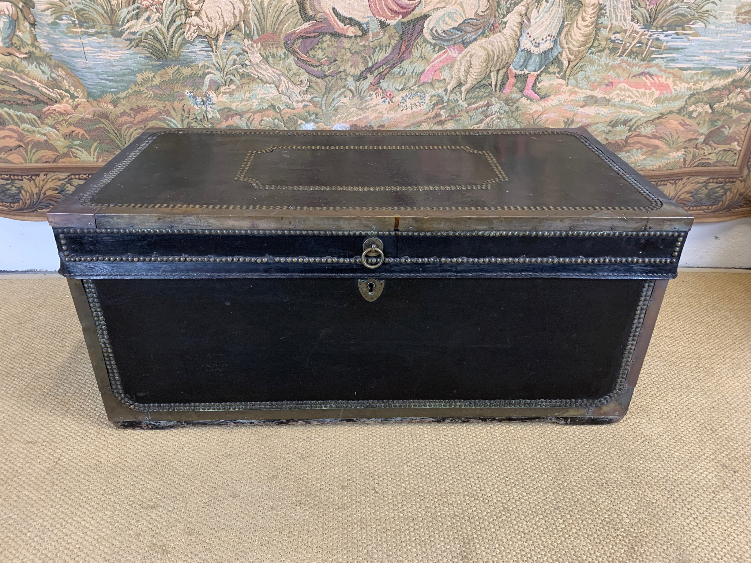 leather and brass bound camphor wood trunk